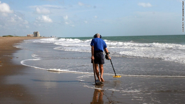 Tim Higginbotham scans a beach near Fort Pierce, Florida, with his metal detector.