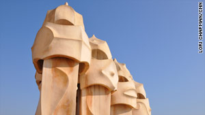 At Casa Mila, alien-like chimneys jut out of the rooftop.