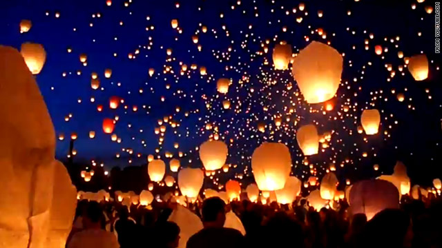 Thousands of paper lanterns float toward the sky in Poznan, Poland, on June 21, the shortest night of the year.