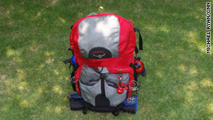 Hiking backpacks have a rigid frame and are designed to put the load on the hiker's hips.