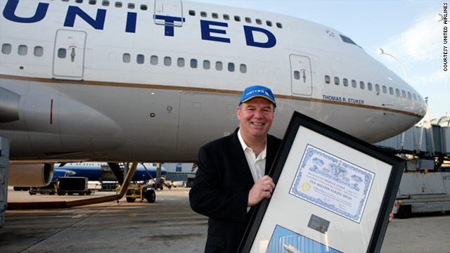 Tom Stuker poses in front of the United Boeing 747-400 named in his honor for earning 10 million frequent flier miles.