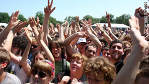 Festival-goers at the 2008 Pitchfork Music Festival in Chicago  cheer an act. This year's event runs July 15-17.