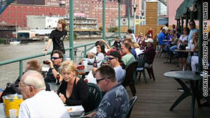 Singles can enjoy seafood and mingling on the waterfront deck at Shooters on the Water in Cleveland.