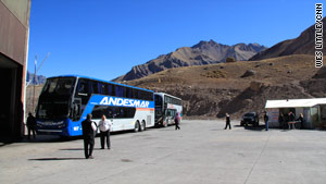 Buses from Chile wait to go through customs at an Argentine border outpost.