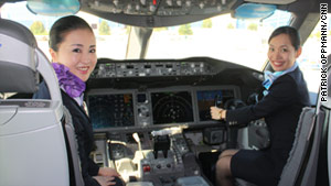 All Nippon Airways' flight attendants pose in the cockpit of a new Boeing 787 Dreamliner on Saturday.