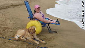 Kelsey Haase visited a beach in Maui with her service dog Emelia in June. Many beaches have accessible paths and offer free beach wheelchairs.