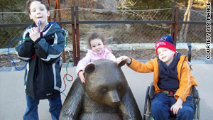 Peter (left), Abby and Stephen Mance visited the National Zoo in Washington this year. Peter brings pipe cleaners everywhere he visits because the familiar item comforts him.