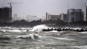 Raging waves whipped up by Hurricane Irene batter the seafront in Santo Domingo, Dominican Republic, on Tuesday.
