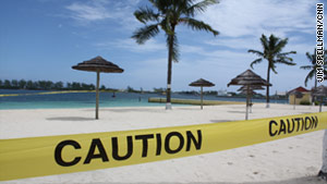 Police tape blocks a beach in in Nassau, Bahamas, on Thursday in preparation for Hurricane Irene.