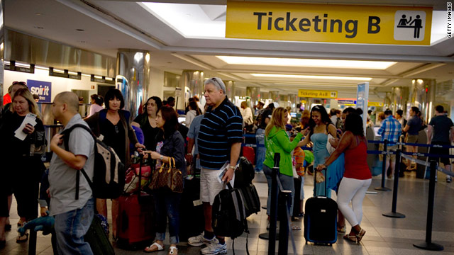 Passengers stand in line at New York's LaGuardia Airport on Monday. East Coast airports have reopened after Hurricane Irene.