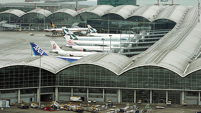 Planes sit parked at Hong Kong International Airport, where the Nepal Airlines passenger jet is grounded.