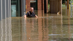 Michael Bunch wades on a flooded downtown sidewalk in Nashville, Tennessee, in May 2010.