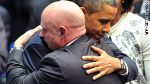 President Obama hugs astronaut Mark Kelly during a memorial to Kelly's wife Wednesday in Tucson, Arizona.