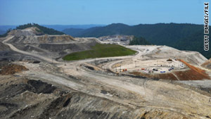 Mountaintop-removal mining uses dynamite on hilltops to expose underlying coal.