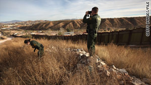 U.S. Border Patrol agents monitor the U.S.-Mexico border on in December 2010 near Nogales, Arizona.