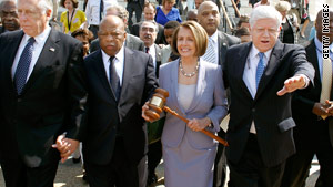 Rep. John Lewis, second from left, marches to the U.S. Capitol last year to vote for health reform.