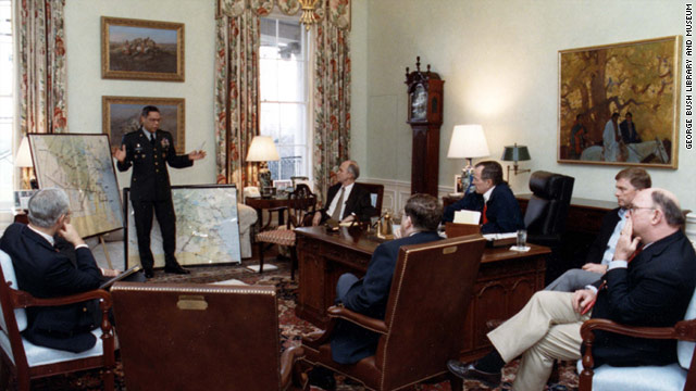 In a 1991 photo, Colin Powell gives a briefing on the Gulf War to, from left, James Baker, Brent Scowcroft, John Sununu, President George Bush, Vice President Dan Quayle and Dick Cheney.