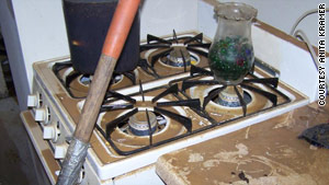 Formerly shiny white appliances were covered in dirt after a broken water main flooded Anita Kramer's basement kitchen.