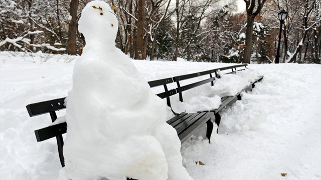 A snowman dons a bench in New York City's Central Park. This week's forecasted storm will likely extend from Oklahoma City to Caribou, Maine.