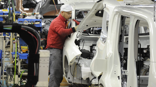 Nissan Motor workers install components into a Leaf electric vehicle on the assembly line of a plant in Yokosuka, Japan.
