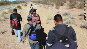 Undocumented immigrants walk in Arizona's Sonoran Desert after illegally crossing the U.S.-Mexico border on January 19.