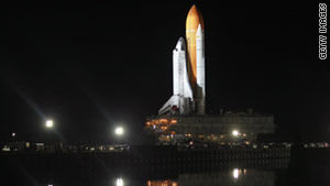 Space shuttle Discovery rolls to the launch pad at Kennedy Space Center on January 31.