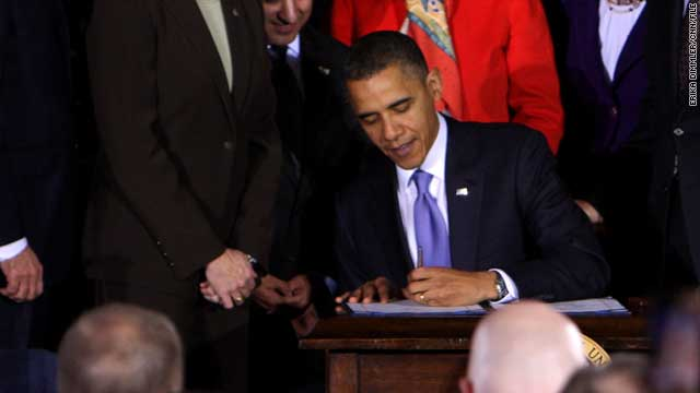President Barack Obama signs the Don't Ask Don't Tell repeal on December 22.