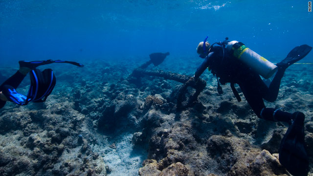 Divers explore the debris field left by the 1823 sinking of the Two Brothers whaling ship, off French Frigate Shoals.