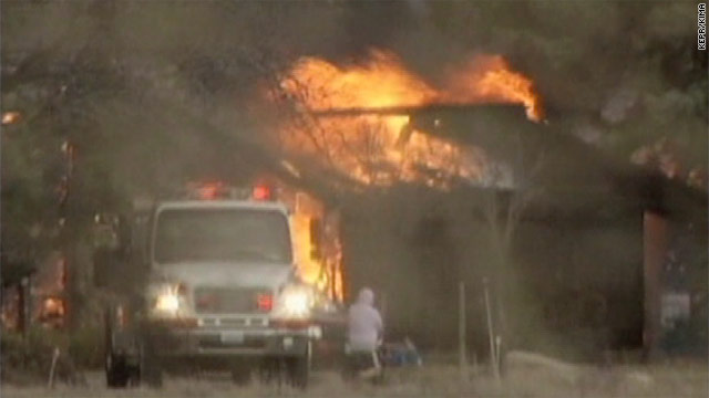 Firefighters battle a blaze that damaged as many as 20 homes on the Yakama Indian Reservation in Washington.