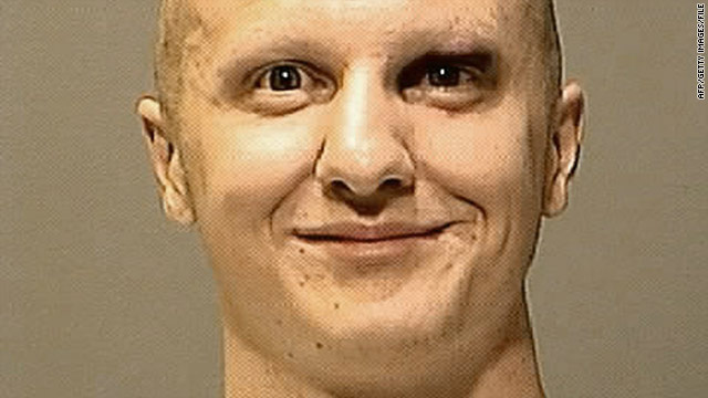 A U.S. District Court judge delayed a ruling on releasing two other mug shots taken on the day of Jared Loughner's arrest.