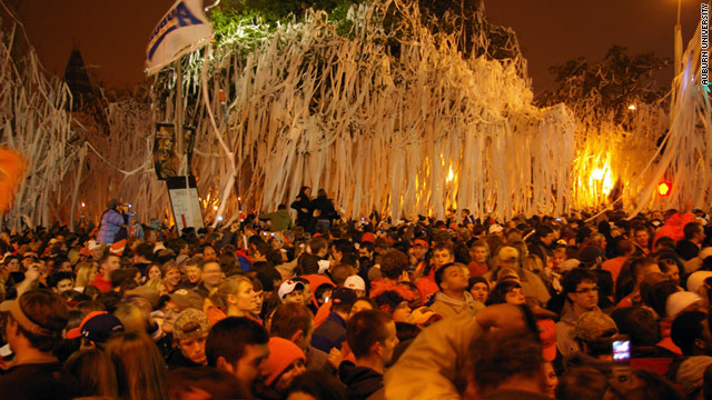 Auburn fans celebrate their January 10 national championship with toilet paper and cheers at the Toomer's Corner trees.