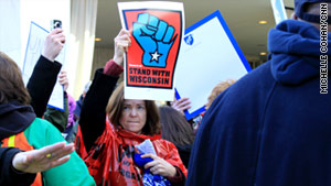 Union activists take their protest to the Washington office of Wisconsin Gov. Scott Walker.