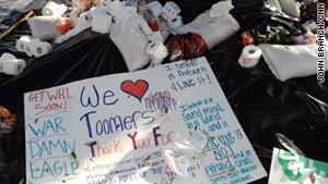 Fans left rolls of toilet paper and signs beneath the Toomer's Corner oaks in Auburn, Alabama.