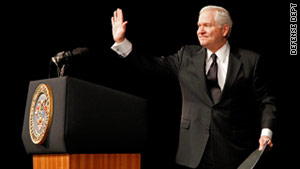 Defense Secretary Robert Gates waves to West Point graduates on Friday.