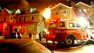 One woman was killed and 20 firefights were injured in the five-alarm blaze.