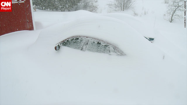 Mark Lanoue of Orleans, Vermont, says he spent much of Monday cleaning his driveway and digging out cars.