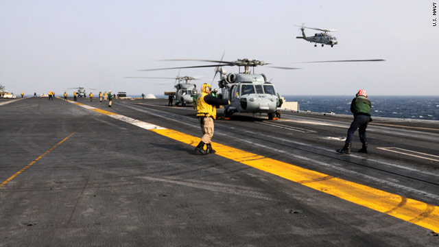 U.S. Navy helicopters take off from the USS Ronald Reagan on Tuesday to provide aid for Japanese earthquake victims.