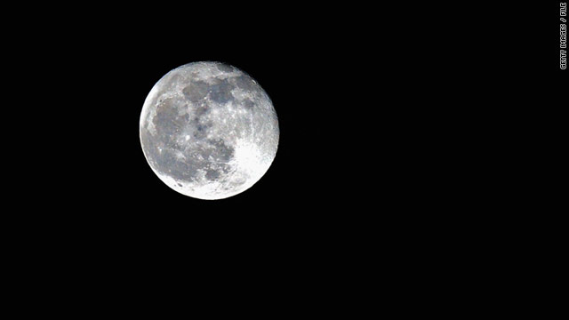 The full moon this weekend will look close enough to touch, but it will still be some 211,600 miles from Earth.