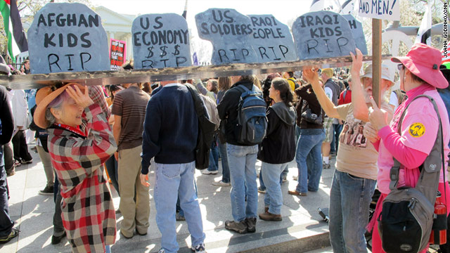 About 1000 antiwar protesters marched in Washington's Lafayette Park on Saturday, the eighth anniversary of the Iraq war.