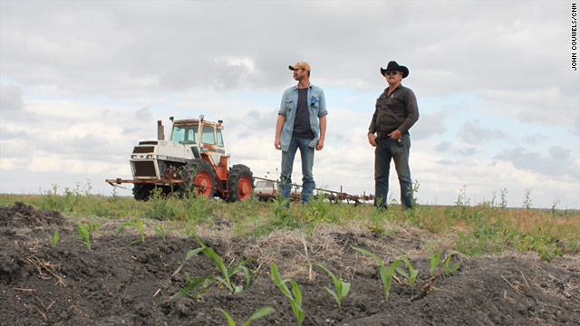 Texas ranchers David Huber, on the right, and his son Jason Huber consider the risks of a proposed nuclear plant, seven miles from their property.