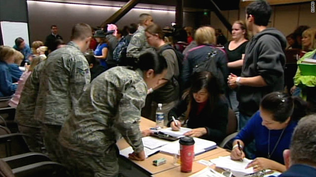 About 200 military family members arrived at Seattle-Tacoma International Airport on Saturday after leaving Japan.