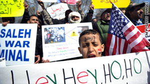 Yemenis shout slogans against Yemen's President Ali Abdullah Saleh Saturday in front of the White House.
