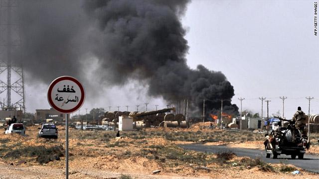 Smoke billows as Libyan rebels progress westward from Bin Jawad toward Moammar Gadhafi's hometown of Sirte on Monday.