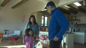 Charles talks with hs wife, Cory, and their daughter at their home in Santa Fe, New Mexico.
