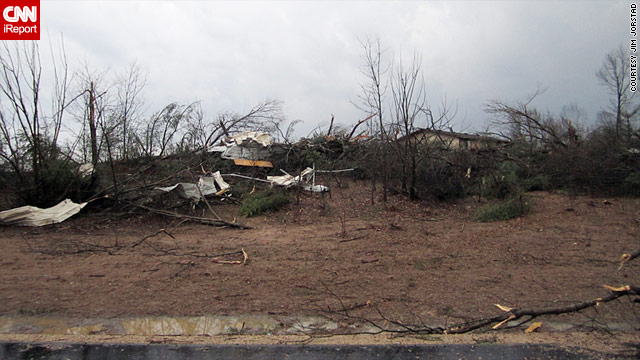 A storm leaves damage behind Sunday in Arkdale, Wisconsin. Northeast of Arkdale, a storm struck 157 homes in Kaukauna.