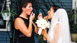 Kirby Brown primps with the bride at Emily Forbes' wedding in September 2002.