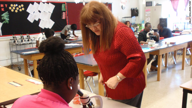 Biology teacher Rosalie Spano helps student Sabrina Ward at Cleveland's Glenville High School.