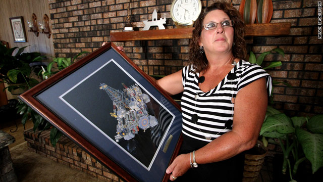Sherri Revette holds an image of Deepwater Horizon given to the family by Transocean in memory of her husband.