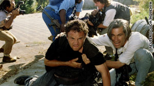 Greg Marinovich, center, was shot and wounded in this 1994 gun battle in a South Africa township.  Colleague Ken Oosterbroek, in the background, did not survive.
