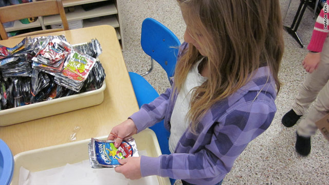 Gabby Truppelli, a fifth grader at East Amwell School in New Jersey, sorts juice pouches, which will be recycled into tote bags.